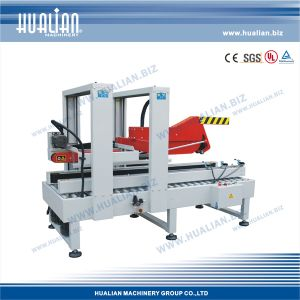 Hualian 2017 Auto Flap Carton Sealer with Three-Side Belts (FXJ-5050ZB) pictures & photos