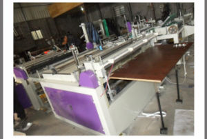 Automatic Non Woven Fabric Roll to Sheets Cross Cutting Machine (DC-HQ 1200) pictures & photos