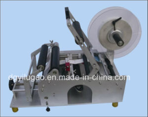 Economic Manual Round Bottle Labeling Machine pictures & photos