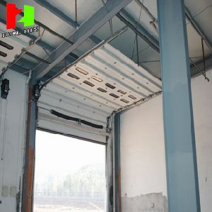 2017 Remote Control Aluminum Profile Industrial Overhead Sectional Roll up Door Automatically Opens (Hz-FC036) pictures & photos