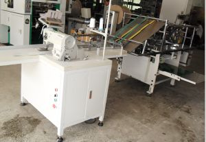Auto Sewing & Folding Paper Machine (ZXFZ-600) pictures & photos