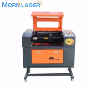 MDF Glass Plastic Paper CO2 Laser Cutting Engraving Machine pictures & photos