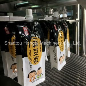 Small Volume Jelly Filling Machine for Spout Side Gusset Pouch pictures & photos