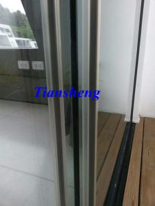 Frameless Stack Glass Sliding Door pictures & photos