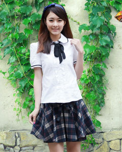 2014 School Uniform with Skirt for Girls (SCHUM130017) pictures & photos