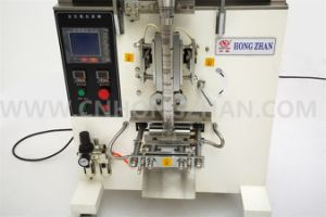 HP100g Grain Snack Seeds Automatic Packing Machine with Electric Scale pictures & photos