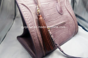 Customized New Metal Leather Tassel Keychain pictures & photos