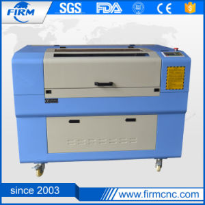 Jinan Small Mini CO2 CNC Laser Engraving Machine for Wood pictures & photos