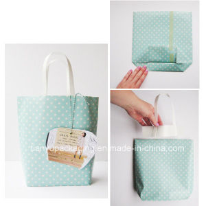High Quality Flat Handle Kraft Paper Gift Bag pictures & photos