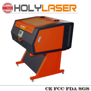 Hot Sale Reci CO2 Laser Cutting Engraving Machine Price pictures & photos