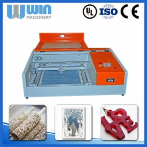 Cheap Price Laser Cutting Machine for Fabric, Leather, Cloth, Textile pictures & photos