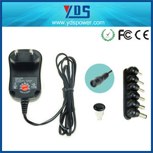 Universal Wall Mounted AC DC 12W 12V 1A Power Adapter pictures & photos