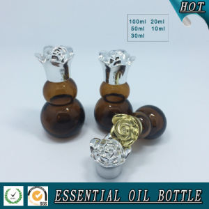 Gourd Amber Essential Oil Glass Bottle with Flower Lid pictures & photos