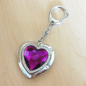Promotion Gift Purple Heart Shaped Purse Hanger with Logo (F2023A) pictures & photos