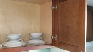 Walnut Solid Upper Cabinets in Faceframe pictures & photos