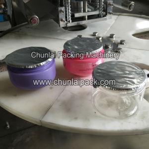 Face Cream Plastic Jar Sealing Machine pictures & photos