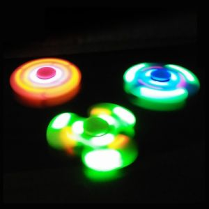 Hand fidget spinner with LED and bluetooth spinner in stock pictures & photos