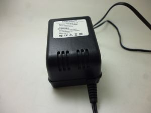 12V 1A Us Standard Plug Power Adapter/AC DC Adapter pictures & photos
