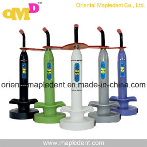 Ce, ISO Approved Dental Colorful LED Curing Light Om-L018 pictures & photos