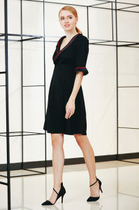 Ruffle Collar and Cuff Elbow Sleeve Solid Swing Dress pictures & photos