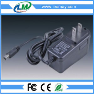 AC/DC5V/12V/24V Wall-Mounted Power Adapter 12W with Ce RoHS pictures & photos