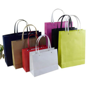 Luxurious Kraft Paper Shopping Bag with Twisted Handle pictures & photos