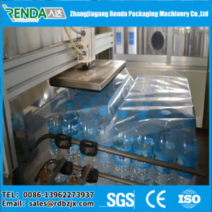 Small Bottle PE Film Heating Shrink Wrapping Machine pictures & photos