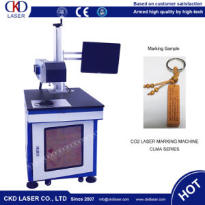 High Peak Power Laser Engraving Machine for Wood pictures & photos