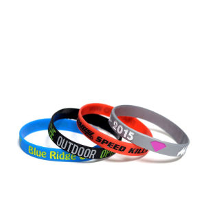Promotional Color Filled Silicone Wristbands Bracelets pictures & photos