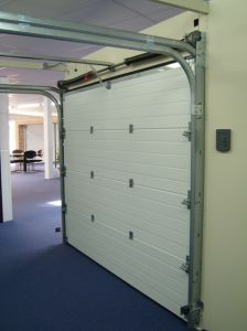 Sectional Industry Lift Doors with Man Door 9*9 Fast Roll-up Sectional Garage (Hz-SD015) pictures & photos