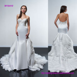 Strapless Bodice Accented with Intricate Beading Wedding Dress with Flare Skirt of Structured Layered Train pictures & photos