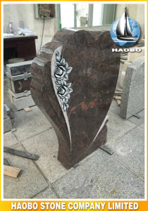 Honed Blue Granite Headstone with Carved Flowers pictures & photos