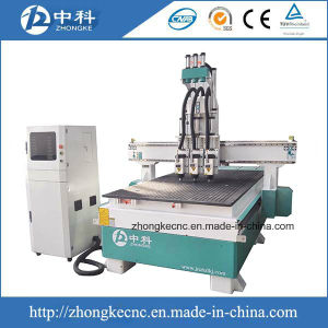 Pneumatic Three Heads Wood CNC Router Machine for Sale pictures & photos