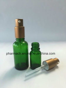 Green Essential Oil Glass Bottle with Emulsion Gold Aluminum Pump pictures & photos