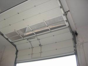 Factory Industrial Sectional Garage Door, with Swing Door in Door pictures & photos