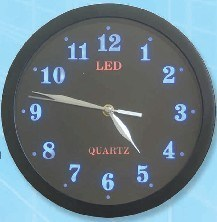 Novelty Promotional Wired Analog Clock with Emitting LED Light pictures & photos
