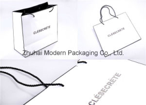 Wholesale Custom Design Shopping Paper Bag with Lamination/UV Coating/Logo Stamping/Embossing pictures & photos