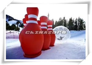 Inflatable Human Bowling Ball with Zorbing Setup on Snow Ramp