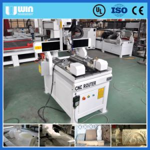 Factory Price Double Rotaries 4 Axis CNC 6040 pictures & photos