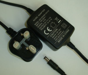 Universal 5V2a AC DC Wall Mounted Switching Power Adapter with EU, UK, Us Plug pictures & photos