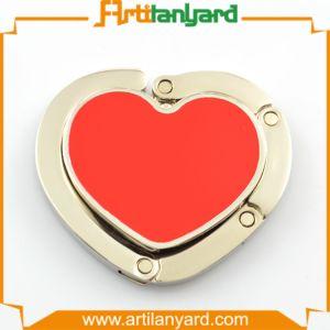 Latest Design Heart Shape Purse Hanger pictures & photos