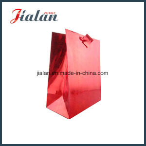 Red Hologram Film Gift Paper Bag with PP Handle pictures & photos