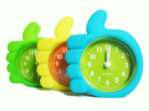 Kid′s Fluorescent Creative Finger Shape Silicone Table Alarm Clock pictures & photos