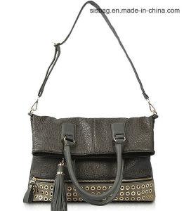 Bark Grain PU Shoulder Bag Eyelet Tote Bag with Tassel pictures & photos