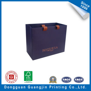 Special Material Paper Shopping Bag with Logo Hot Stamping pictures & photos