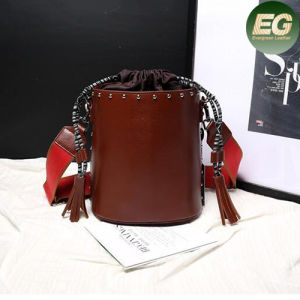 Fashion Studded Handbag Real Leather Bucket Shoulder Bag Drawstring Tassels Emg4862 pictures & photos