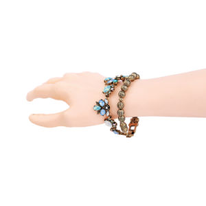 New Retro Two-Layer Beaded Inlaid Rhinestone Flower Design Women′s Bracelet pictures & photos