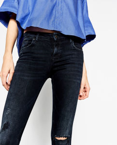 Fashioned Women Skinny Pant with Holes pictures & photos