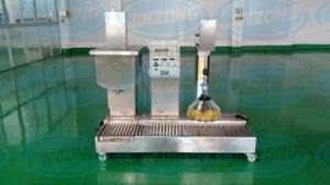 Automatic Gravity Filling Machine with Capping pictures & photos