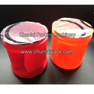 Auto Plastic Jar Sealing Machine pictures & photos